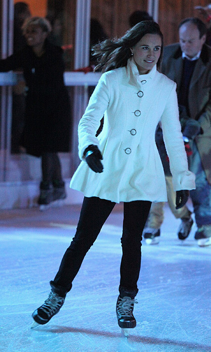 Pippa hit the ice in a winter white coat and black gloves.