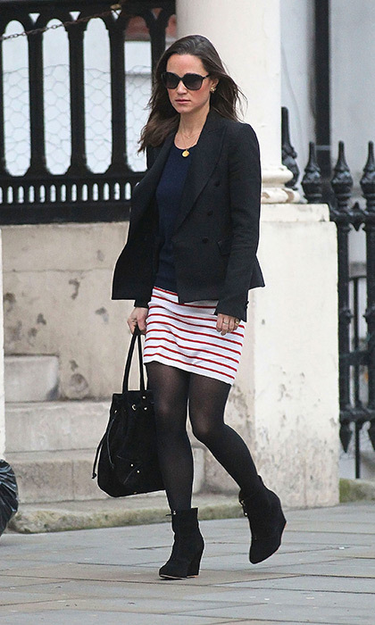 Pippa added some color to this dark look with a red and white striped skirt.