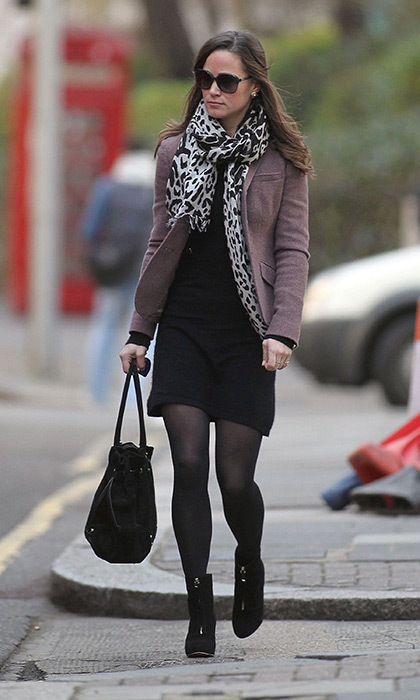 Pippa accessorised this black ensemble with an animal-print scarf and purple blazer.