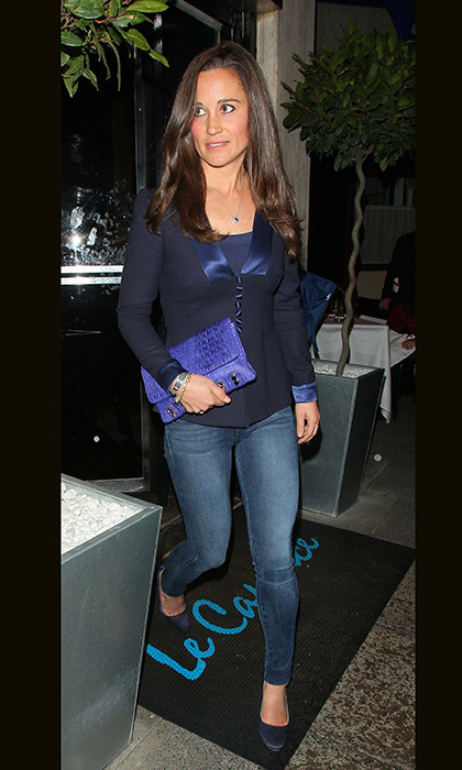 Pippa paired her skinny jeans with navy flats, a navy blouse and matching blue clutch for a dinner date.