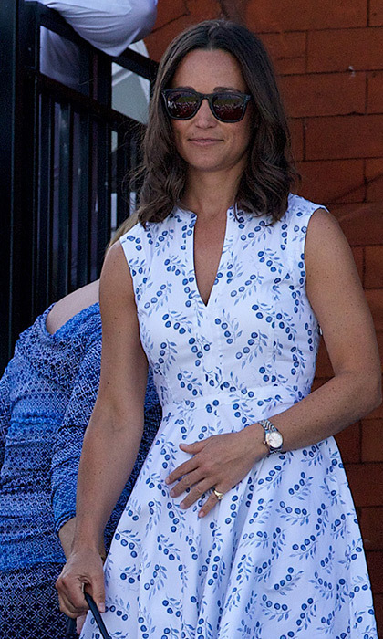 The British beauty kept it light and airy with this white and blue printed sundress.