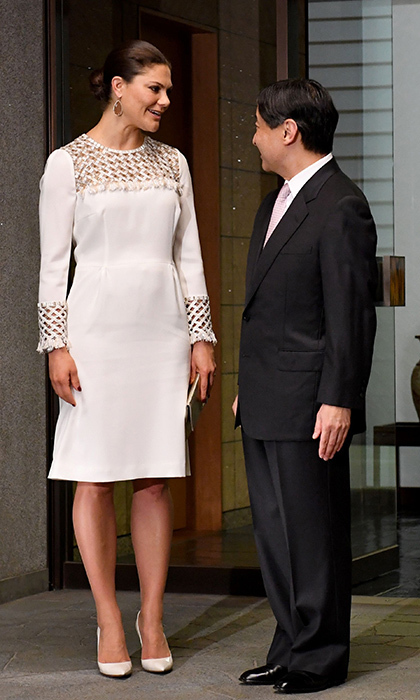 Crown Princess Victoria of Sweden wore a white dress with embellished neckline and sleeves as Japanese Crown Prince Naruhito welcomed her to Togu Palace in Tokyo.