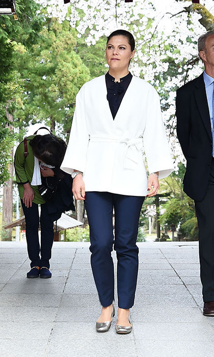 Crown Princess Victoria of Sweden visited Shiogama Shinto Shrine in Japan, wearing a kimono-style wrap jacket, and silver flats. 