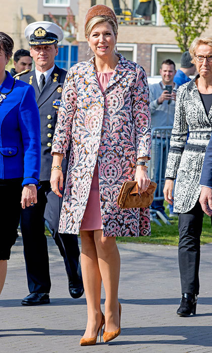 Queen Maxima of the Netherlands wore muted and matching accessories to play off her patterned pink coat for her visit to social restaurant Resto VanHarte.