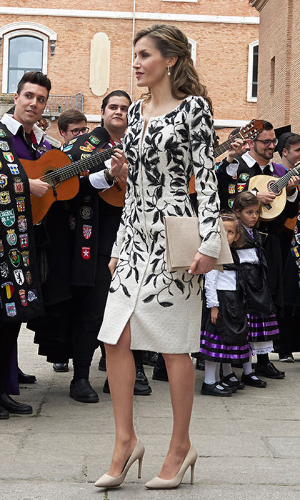 Queen Letizia of Spain attended the Miguel de Cervantes Awards in an embroidered Felipe Varela coatdress. Her slim clutch was a match for her heels by Spanish designer Magrit. 