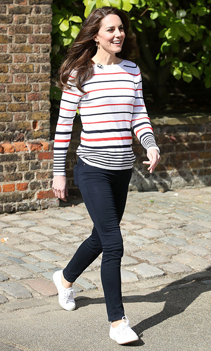 Wearing a striped sweater by Luisa Spagnoli and white Superga sneakers, a dressed-down Duchess of Cambridge hosted a special Heads Together reception for London marathon runners at Kensington Palace. 