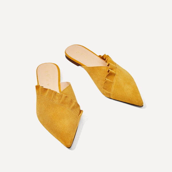 "<p>Leather Mules with Frill, $50, <a href=""https://www.zara.com/ca/en/woman/shoes/view-all/leather-mules-with-frill-c719531p4333510.html"" target=""_blank"">Zara</a>.</p>"