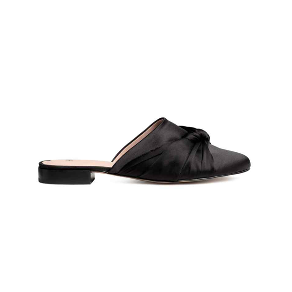 "<p>Black Satin Slip-ons, $30, <a href=""http://www2.hm.com/en_ca/productpage.0471292001.html#Black"" target=""_blank"">H&M</a>.</p>"
