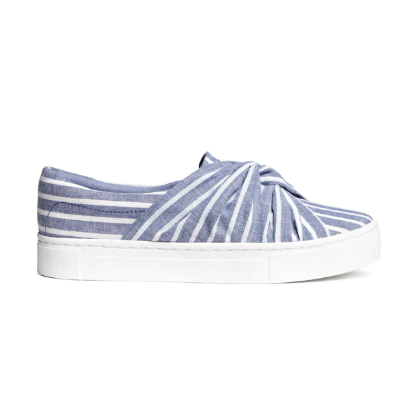 "<p>Knot-detail Trainers, $40, <a href=""http://www2.hm.com/en_ca/productpage.0490666001.html#Blue/Striped"" target=""_blank"">H&M</a>.</p>"