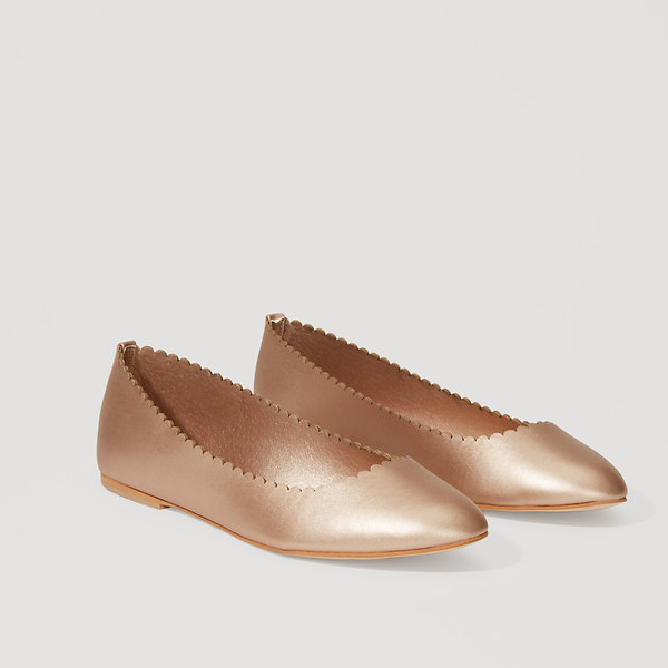 "<p>Metallic Scalloped Ballet Flats, $84, <a href=""https://www.loft.com/metallic-scalloped-ballet-flats/429151"" target=""_blank"">Loft</a>.</p>"