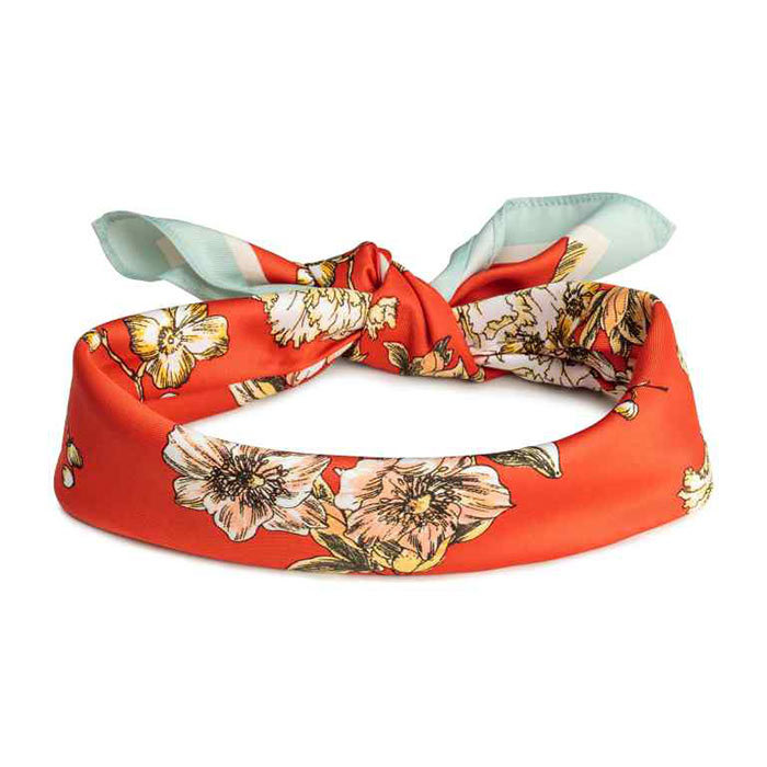 <p>Scarf/Hairband in Orange/Floral, $13, <em>hm.com</em></p>
