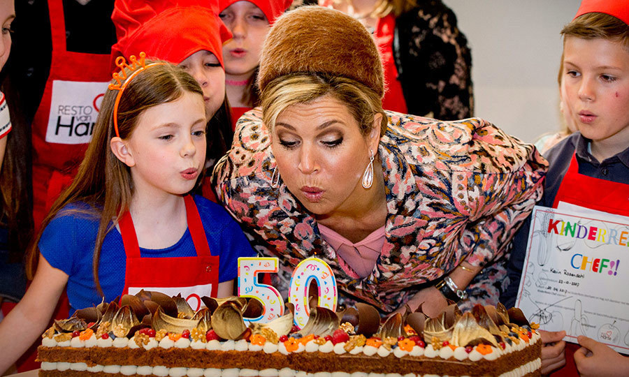 Make a wish! Queen Maxima of the Netherlands helped a young friend blow out some candles on April 20 in Lelystad, Netherlands.