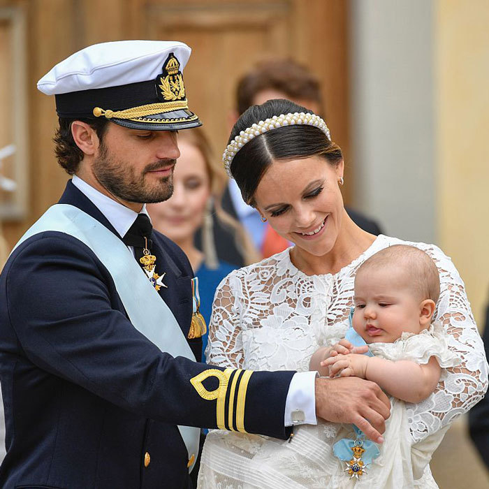 Prince Carl Philip and Princess Sofia doted on their baby boy on his special day in Stockholm.