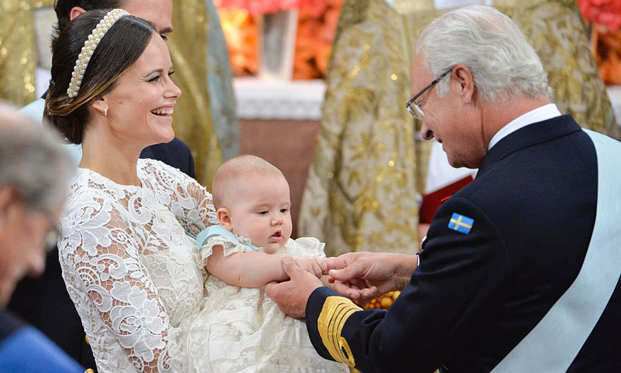 King Carl Gustaf was one proud grandfather holding hands with Prince Alexander at his christening. 