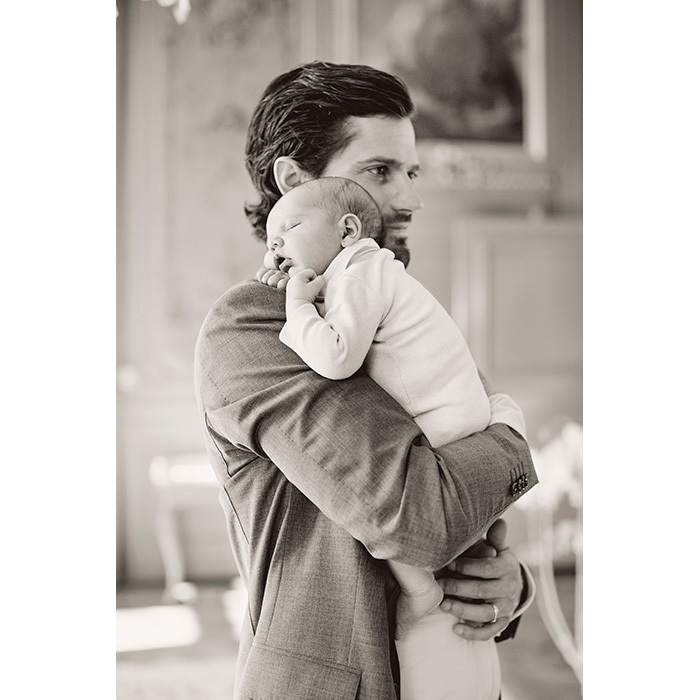 Prince Carl Philip cuddled his sleeping baby on his chest in a tender father-son portrait from the shoot.