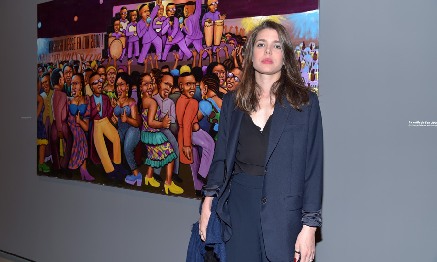 "Charlotte Casiraghi attended the ""Art/Afrique, Le Nouvel Atelier"" exhibition opening at the Louis Vuitton Foundation building in Paris on April 25. The Monaco royal looked effortlessly chic for the outing wearing a black tank, which she paired with high-waisted navy trousers and a matching blazer.