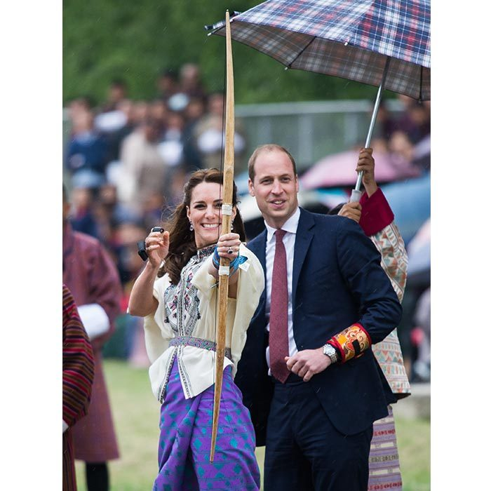During the couple's 2016 tour of Bhutan, Kate laughed off tips from her husband as she showed off her impressive archery skills in Thimphu.