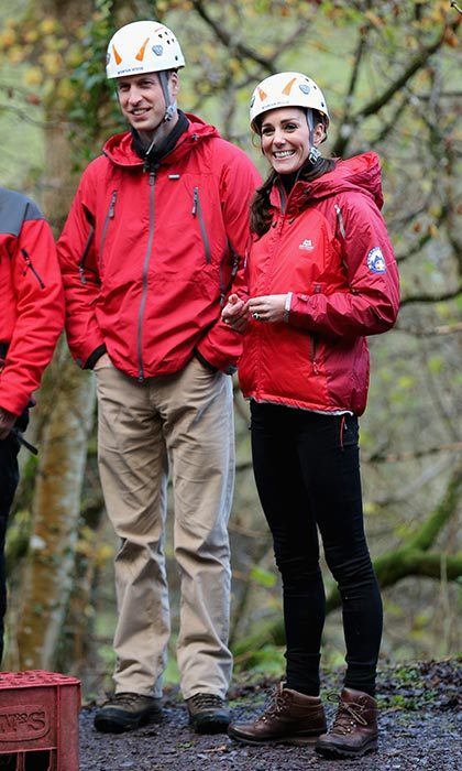 William and Catherine are ready for an adventure! The couple wore matching helmets and bright red jackets while waiting for their turn to zip line at the Towers Residential Outdoor Education Centre in in 2015. 