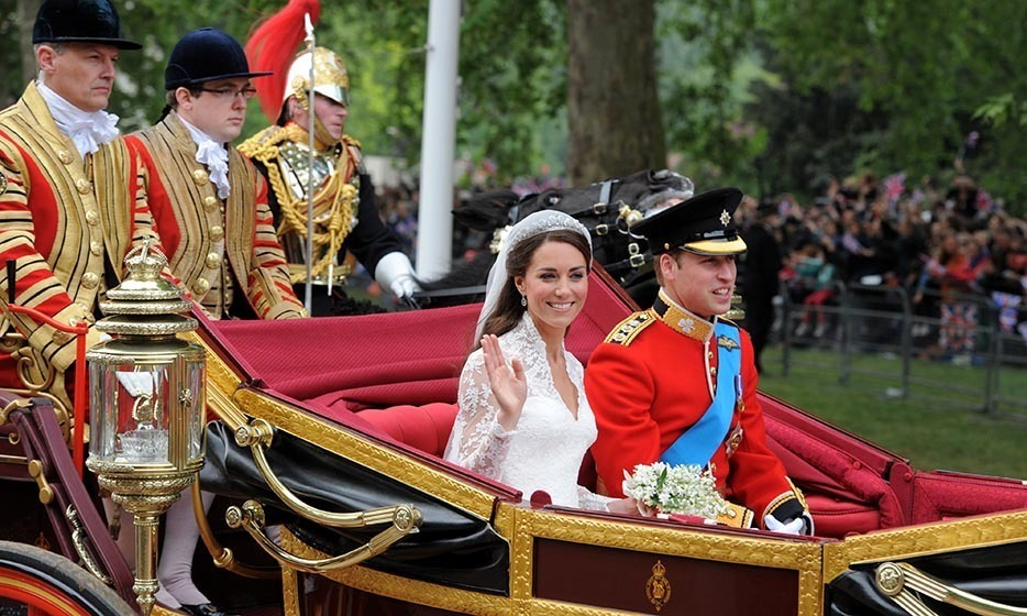 The newlyweds took a quick trip in the 1902 State Landau carriage along the Processional Route to Buckingham Palace while waving at the cheering crowds.