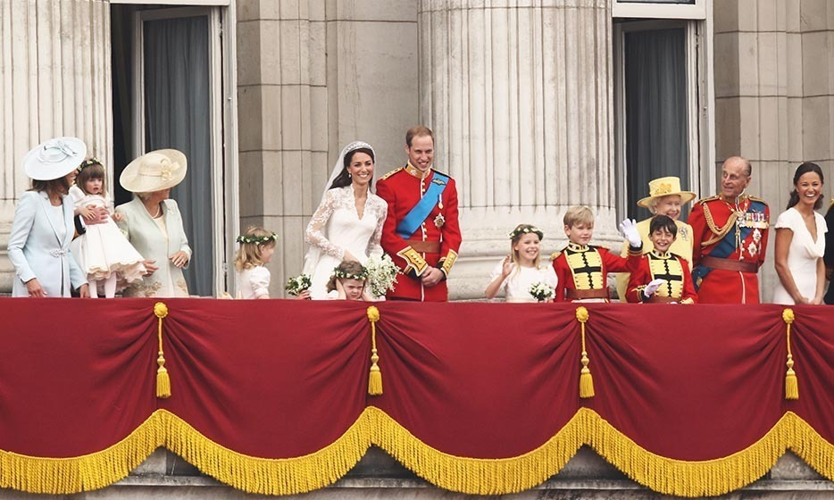 The happy couple and their jubilant families took their places on the balcony of Buckingham Palace.
