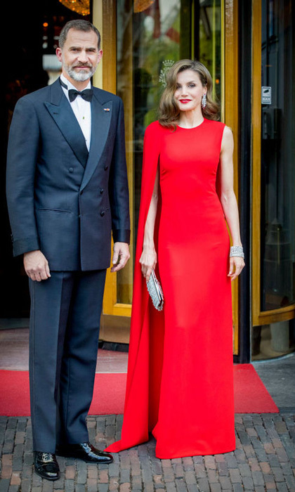 Queen Letizia and King Felipe VI helped King Willem-Alexander celebrate his 50th birthday in The Hague, Netherlands. Spain's Queen wore a red caped gown by Stella McCartney for the private affair.