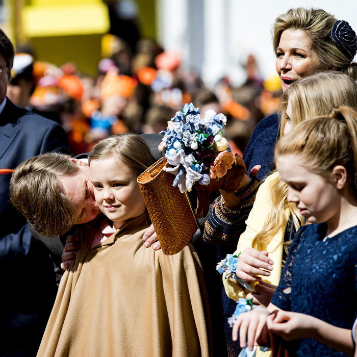 The birthday King placed a sweet kiss on his ten-year-old daughter, Princess Ariane, during his King's Day celebrations.