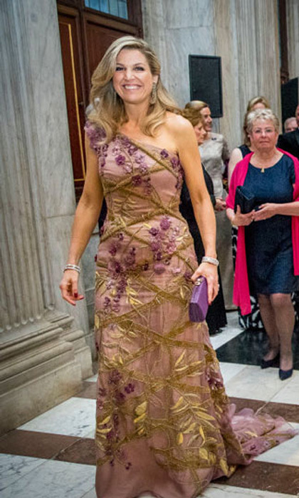Queen Maxima invited 150 guests to the palace for King Willem-Alexander's birthday celebration where she stunned in an embellished one-shouldered gown.