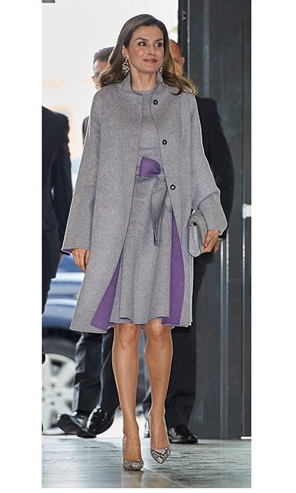 The Spanish queen layered up in a grey ensemble with hints of regal purple for an unseasonably chilly day at Cardenal Herrera University in Valencia, Spain.