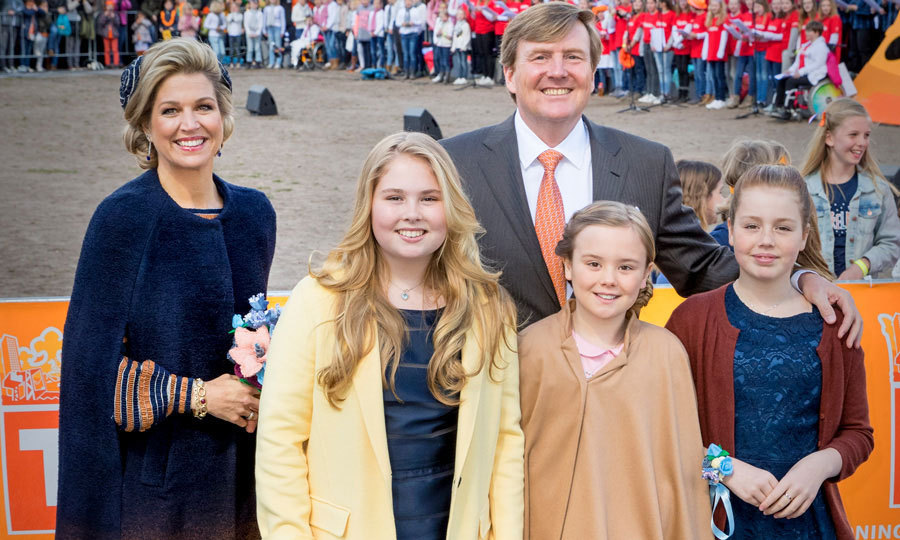 Queen Maxima and her daughters Princess Amalia, Princess Alexia and Princess Ariane coordinated in cozy earth tones at King Willem-Alexander's 50th birthday celebration in Tilburg, Netherlands. 
