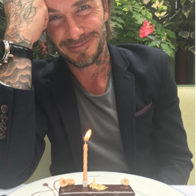 Victoria shared a photo of David with a birthday cake. 