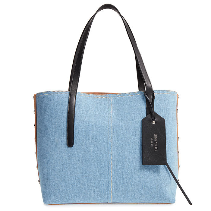 <p>Jimmy Choo Twist East West Denim Tote, $1,150, <em>nordstrom.com</em></p>