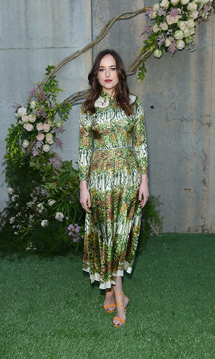 Dakota Johnson looks summer ready at Gucci Bloom fragrance launch.