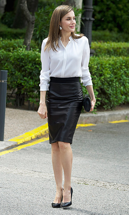 May 4: Queen Letizia of Spain opted for one of her fave wardrobe staples – a leather pencil skirt – for the opening of an exhibition at the National Library in Madrid.