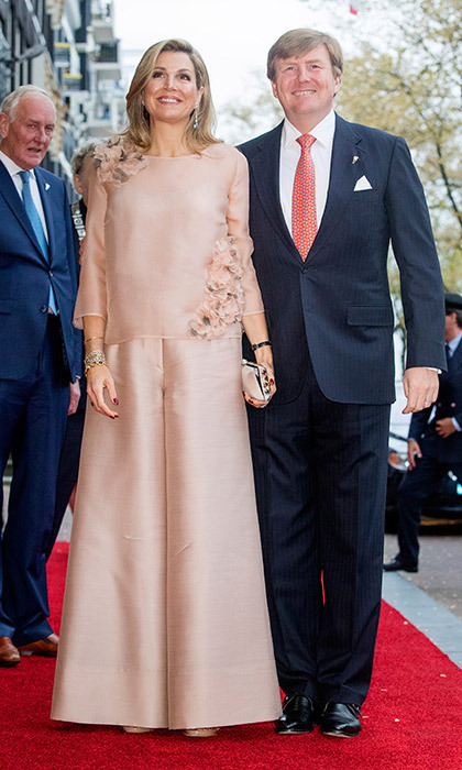 May 5: Queen Maxima of The Netherlands donned a silk flower-embroidered blouse and ultra-wide leg trousers as she joined husband King Willem-Alexander at theannual Liberation Day concert on the Amstel in Amsterdam.