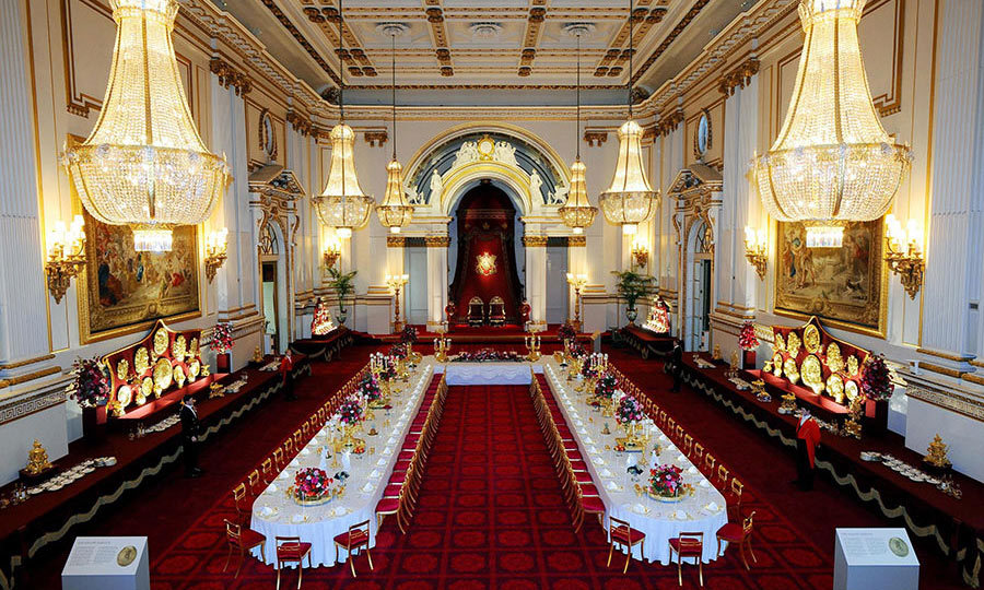 <p><strong>Buckingham Palace</strong></p><p>In the summer months when the Queen and Prince Philip retreat to Balmoral in Scotland, the doors of Buckingham Palace are thrown open for members of the public to visit. Here the Ballroom has been been arranged so that visitors can experience a royal State Banquet.</p><p>Photo: &copy; Getty Images</p>
