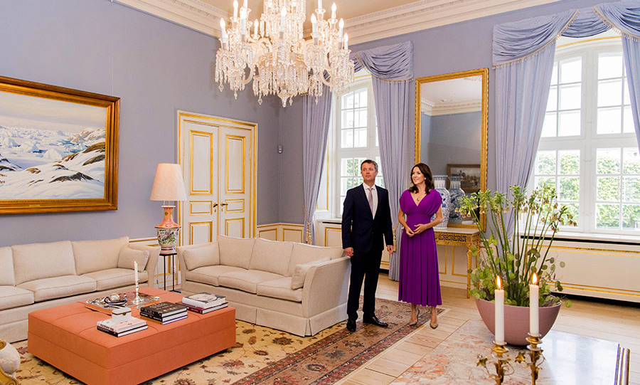"<p><strong>Amalienborg Palace in Denmark</strong></p><p>Crown Prince Frederik and <strong><a href=""/tags/0/princess-mary/"">Crown Princess Mary of Denmark</a></strong> threw open the doors of Amalienborg Palace&nbsp;last summer to host a dinner. It was the first time fans were given a clearer look at the couple's living room, which boasts a magnificent chandelier as its focal point.</p><p>Two sofas in neutral tones and two chairs are centred around&nbsp;a cushioned coffee table, and sit on&nbsp;tapestry rugs.</p><p>Beautiful plants and flowers, candles and coffee table books are dotted around the room, while&nbsp;floor-length curtains complete the elegant interior design.</p><p>Photo: &copy; Rex</p>"