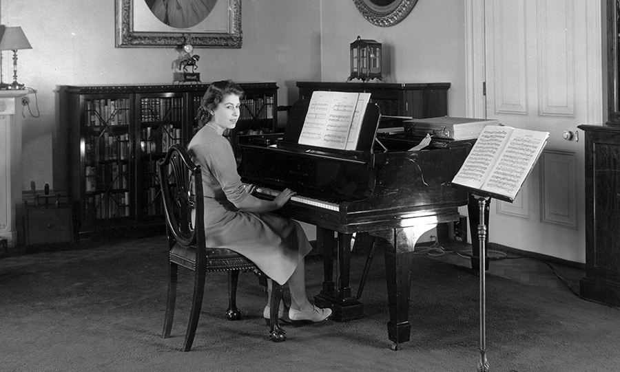 <p><strong>Buckingham Palace</strong></p><p>Over the years, hundreds of portraits&nbsp;of the Queen have been taken at Buckingham Palace, but some of her earliest pictures are the most endearing, such as this&nbsp;black-and-white snapshot taken in July 1946, when the royal, then Princess Elizabeth, sat and played the piano in the State Apartments.</p><p>Photo: &copy; Getty Images</p>