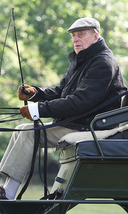 Prince Philip drives his carriage at the Royal Windsor Horse Show. 