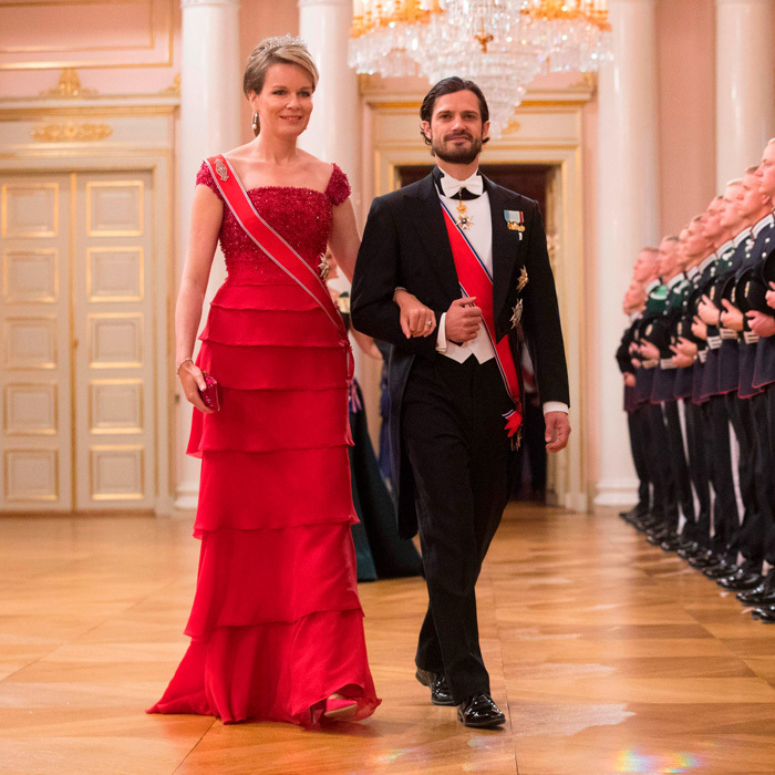 Meanwhile, her husband Prince Carl Philip walked into the dinner with Belgium's Queen Mathilde.