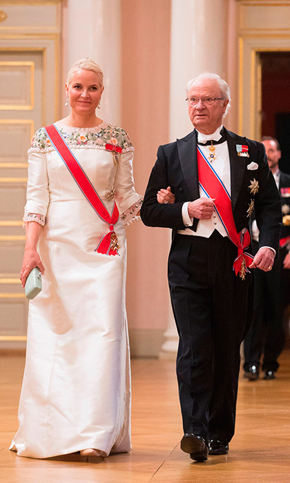 Princess Mette-Marit of Norway was escorted by King Carl Gustaf of Sweden.