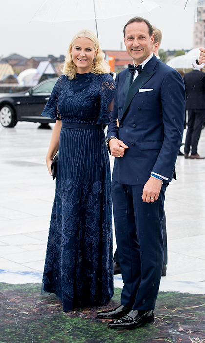 Princess Mette-Marit and Prince Haakon of Norway looked picture perfect in matching navy ensembles.