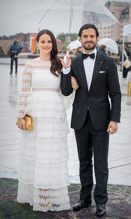 Mom-to-be Sofia looked lovely in a tiered white gown alongside her husband Prince Carl Philip. 