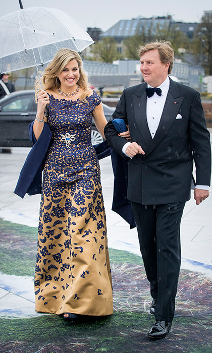 Queen Maxima shined in gold and purple as she arrived to the Opera House with husband King Willem-Alexander. 