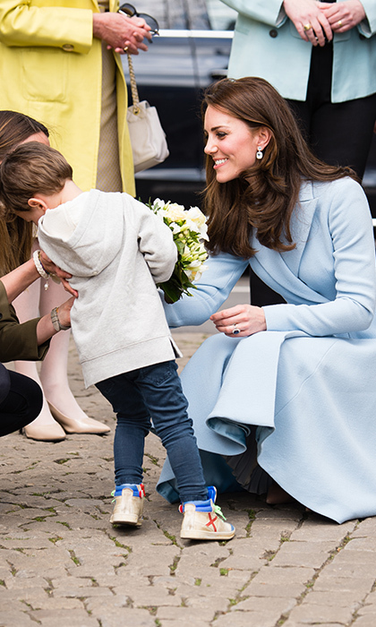 During her visit to Luxembourg on May 11, the Duchess of Cambridge jumped to console a young boy who burst into tears after presenting her with a floral bouquet. The adorable youngster sought out refuge in his mom's loving arms while a caring Kate tried her best to lift his spirits. 