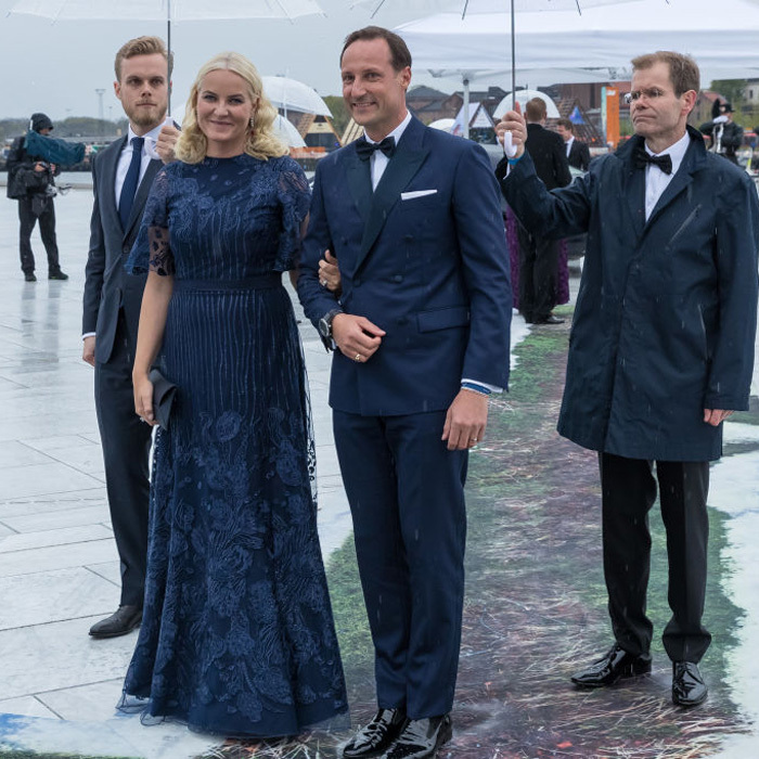 Norway's Crown Princess Mette-Marit matched her husband Crown Prince Haakon in navy for a night at the opera.