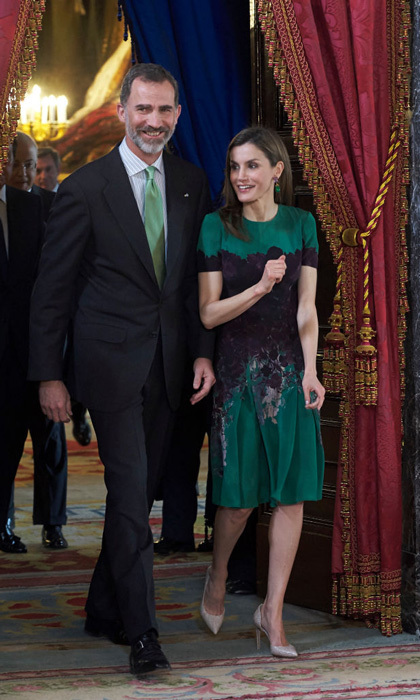 Queen Letizia turned heads in a green and purple Carolina Herrera dress during a luncheon with Costa Rica's President Luis Guillermo Solis and his wife Mercedes Penas Domingo in Madrid. 