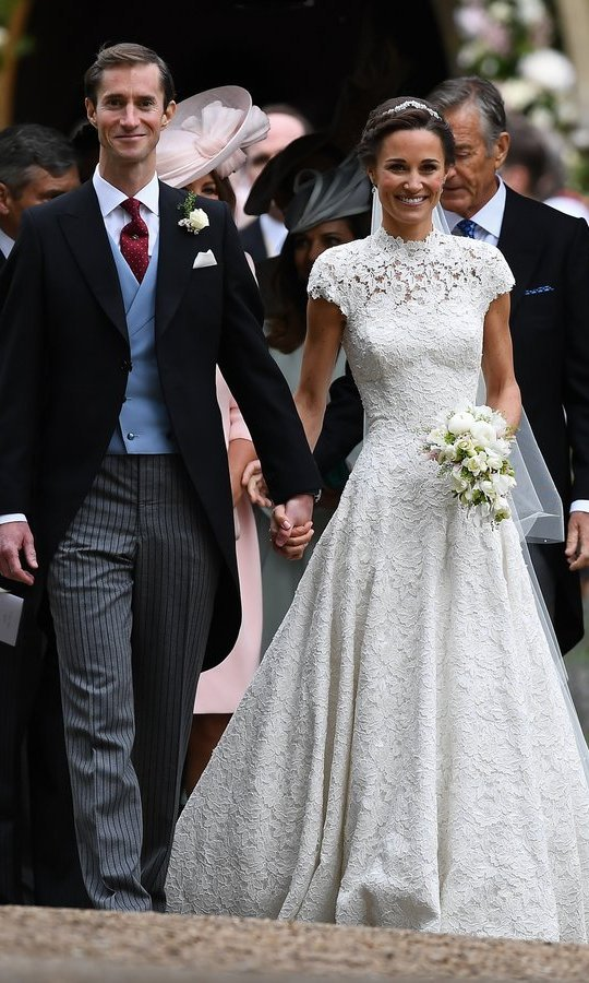 The newlyweds left the church hand in hand.