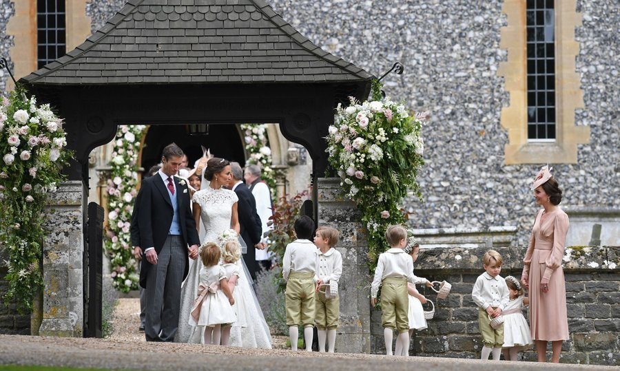 With James chatting to a flower girl, Pippa, Kate and the wedding party gathered outside the church as they prepared to head to the wedding lunch.