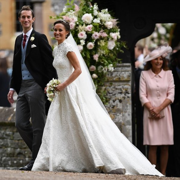 Proud mother of the bride Carole Middleton looked on as her daughter and new son-in-law left the church grounds.
