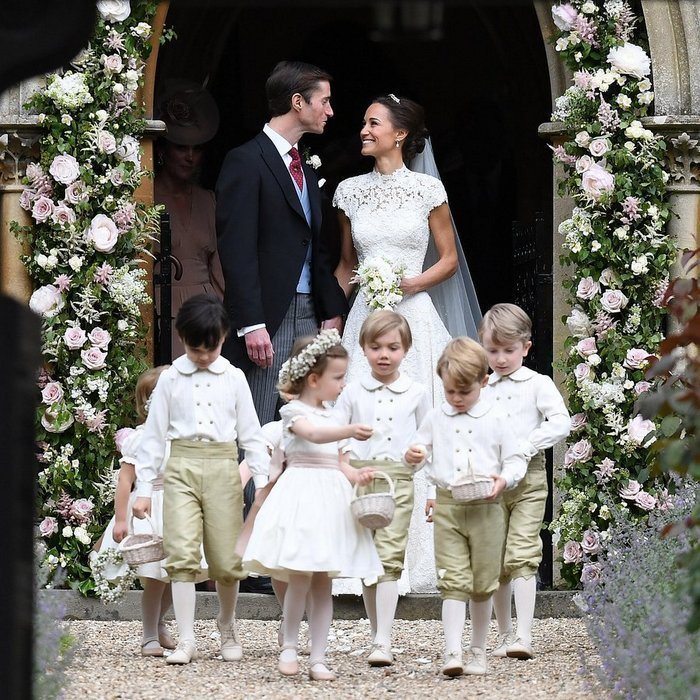 Talking behind their page boys and flowergirls, Pippa and James couldn't have looked happier as they emerged from the church as husband and wife.